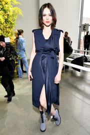 Coco Rocha looked effortlessly cool in a sleeveless navy duster by Jason Wu during the label's Fall 2018 show.