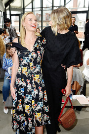 Jaime King attended the Jason Wu fashion show carrying a croc-embossed leather bag from the label.