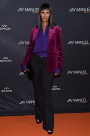 Iman's wine-colored velvet blazer and purple wrap top at the Jay Manuel Beauty x Simon launch were a gorgeous color combo!
