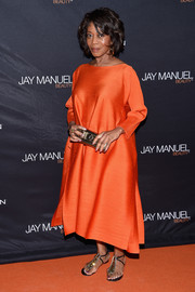 Alfre Woodard looked simply elegant in this loose orange silk dress at the Jay Manuel Beauty x Simon launch.