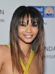 Chanel Iman attended a Jay-Z concert benefiting the United Way wearing her layered 'do sleek and straight with choppy lash-length bangs.