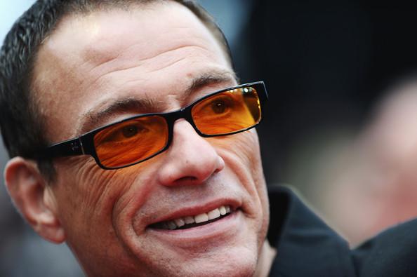 Jean-Claude Van Damme Square Sunglasses [you will meet a tall dark stranger premiere,you will meet a tall dark stranger premiere,eyewear,face,glasses,facial expression,forehead,head,eyebrow,nose,chin,smile,jean-claude van damme,cannes,france,cannes film festival,annual cannes film festival,palais des festivals]