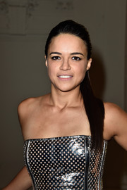 Michelle Rodriguez attended the Jean Paul Gaultier Couture show wearing her hair in a sleek and elegant ponytail.