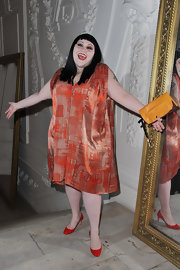 Beth Ditto wore a silk shift dress with a delicate orange pattern for the Jean Paul Gaultier Couture show.