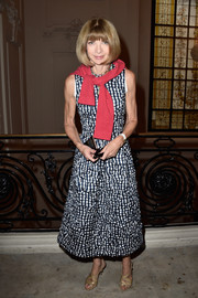 Anna Wintour chose a crinkled gingham dress and her ubiquitous Manolo Blahniks for the Jean Paul Gaultier Couture show.