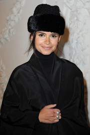 Miroslava Duma teamed a black fur hat with a silk coat for the Jean Paul Gaultier fashion show.
