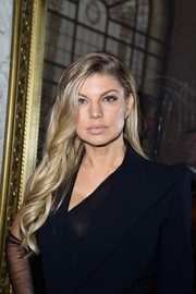 Fergie wore her tresses in a lovely cascade of waves during the Jean Paul Gaultier Couture show.