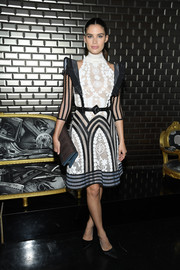 Sara Sampaio looked ultra girly in a black-and-white lace cocktail dress at the Jean Paul Gaultier Couture show.