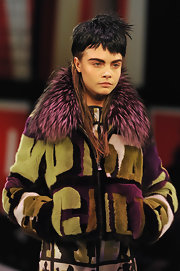 Cara Delevingne rocked her runway look wearing a fur collared jacket from Jean Paul Gaultier's Fall/Winter 2013 collection.