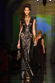 Cindy Bruna sashayed down the Jean Paul Gaultier Couture runway looking fierce in a laser-cut leather gown.