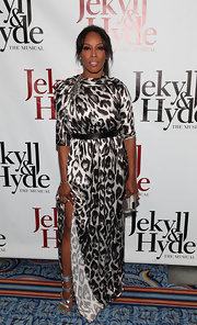 June Ambrose posed at the arrivals of 'Jekyll and Hyde: The Musical' showing off her gorgeous metallic gladiator heels.