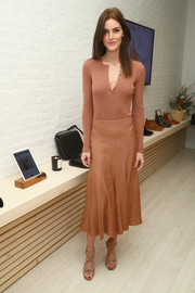Hilary Rhoda styled her monochromatic outfit with strappy gold heels.