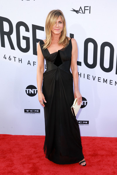 Jennifer Aniston Leather Clutch [flooring,shoulder,carpet,fashion model,dress,little black dress,fashion,red carpet,gown,cocktail dress,dolby theatre,california,hollywood,american film institutes 46th life achievement award gala tribute,george clooney,arrivals,jennifer aniston]