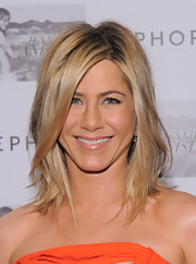 Jennifer Aniston styled her shoulder length locks in a textured hairstyle at her new fragrance launch.