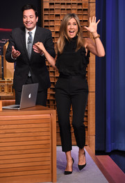 Jennifer Aniston appeared on 'The Tonight Show' wearing a chic black ruffle blouse by Givenchy.