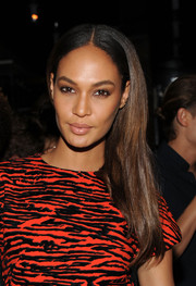 Joan Smalls didn't need much more than this simple center-parted hairstyle to look gorgeous during the Jennifer Fisher NYC flagship store opening.