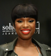 Jennifer Hudson rocked stark bangs during the anniversary of her Soho Jeans collection.