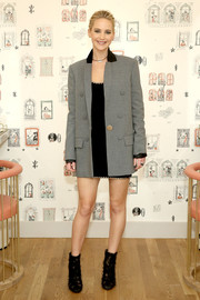 Jennifer Lawrence sealed off her look with a pair of chiffon and leather ankle boots by Christian Louboutin.