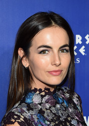 Camilla Belle wore her hair loose and straight with a center part when she attended the 'Jennifer Lopez: All I Have' after-party.