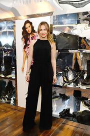 J.Lo rocked a halter jumpsuit with wide legs while promoting her new Kohl's Collection.