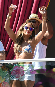 Jennifer Lopez donned a mosaic-print bikini by Emilio Pucci for the Carnival Del Sol pool party.