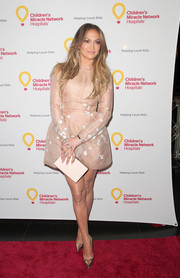 Jennifer Lopez looked darling in an embroidered nude mini dress by The 2nd Skin Co. during the launch of Put Your Money Where the Miracles Are.