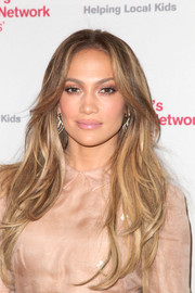 Jennifer Lopez wore her hair down in wavy layers during the launch of Put Your Money Where the Miracles Are.
