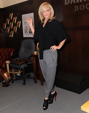 Jenny McCarthy paired her grey trousers with Loubout ankle boots, which were the perfect addition to her tailored look.