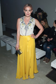 Hilary Duff attended the Jenny Packham fashion show wearing a sleeveless beaded blouse from the label.