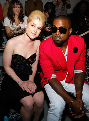 Kanye rocked a coo pair of aviator shades while hitting the Jeremy Scott show.