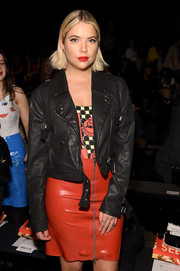 Ashley Benson went tough up top in a black leather moto jacket when she attended the Jeremy Scott fashion show.