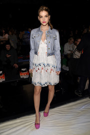 Barbara Palvin topped off her dress with a cropped denim jacket.