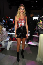 Chiara Ferragni pulled her outfit together with a pair of black mid-calf boots.