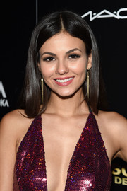 Victoria Justice stuck to her usual center-parted style when she attended the 'Jeremy Scott: The People's Designer' after-party.