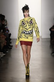 Cara Delevingne wore wedged lace-up booties to match her yellow sweater at the Fall 2013 Jeremy Scott fashion show.