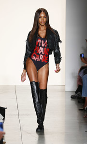 A cropped leather jacket toughened up Jourdan Dunn's swimwear.