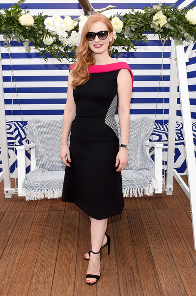 Jessica Chastain Midi Dress [the hollywood reporter,clothing,dress,black,shoulder,eyewear,cocktail dress,fashion,little black dress,waist,footwear,reporter,jessica chastain,grey goose terrace,hollywood,cannes,france,directv,cannes film festival,cocktail party]