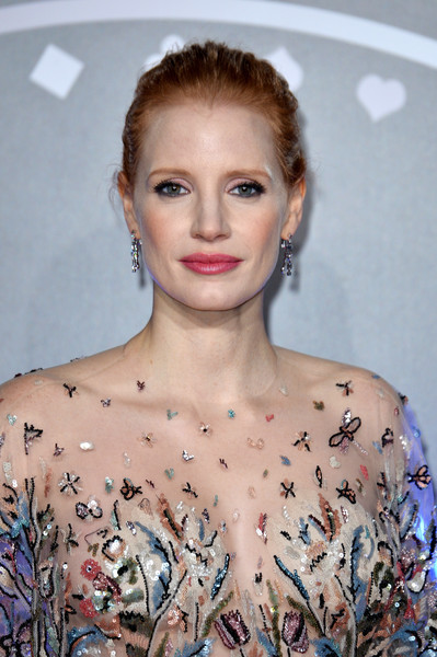 Jessica Chastain Classic Bun [photo,hair,face,hairstyle,lip,shoulder,eyebrow,beauty,fashion,chin,blond,red carpet arrivals,jessica chastain,mollys game uk,caption,vue west end,london,getty images,premiere,premiere]