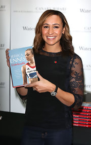 Jessica Ennis dressed up her jeans with a fitted black lace-panel blouse for her book signing.