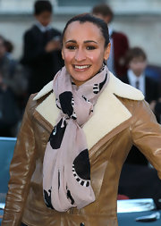 Jessica Ennis' mauve scarf added a feminine touch to her leather jacket during her Jaguar photocall.