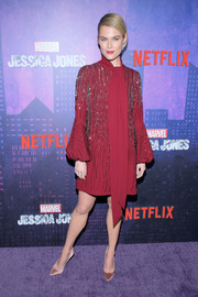 Rachael Taylor kept it classy in a beaded red J. Mendel dress with blouson sleeves and scarf detail at the New York premiere of 'Jessica Jones' season 2.