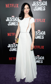 Krysten Ritter is sophisticated and chic in a floor-length white dress with sheer cut-outs along the bodice at the 'Jessica Jones' series premiere.
