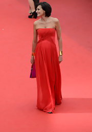 Ines de la Fressange's red strapless gown flowed effortlessly on the red carpet.