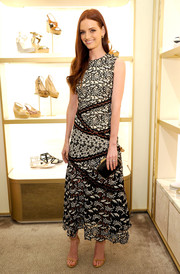 Lydia Hearst finished off her look with a black and gold hard-case clutch.