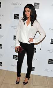 Jessica Szohr dressed up her jeans and blouse with black satin bow-detailed Zodiac peep toes.