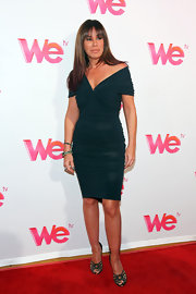 A pair of statement peep-toe pumps played the perfect complement to Melissa's simple-stylish dress.