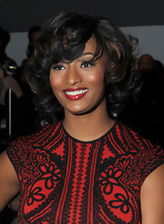 Toccara Jones attended the Joanna Mastroianni fall 2012 fashion show wearing a glossy rich raspberry lipstick.