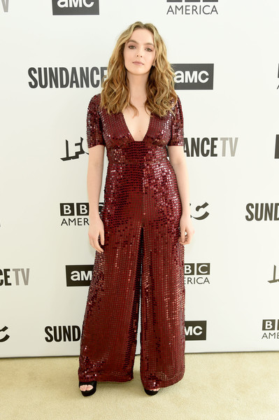 Jodie Comer Jumpsuit [clothing,red carpet,fashion model,red,carpet,dress,hairstyle,long hair,maroon,fashion,carpet,dress,jodie cormer,actor,celebrity,red carpet,fashion model,red,new york city,amc network summit,jodie comer,killing eve,chloe gemell,villanelle,celebrity,actor,television,photograph,image,poster]