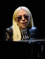 Lady Gaga went for ultra-modern styling with a pair of purple shades by Bob Sdrunk.