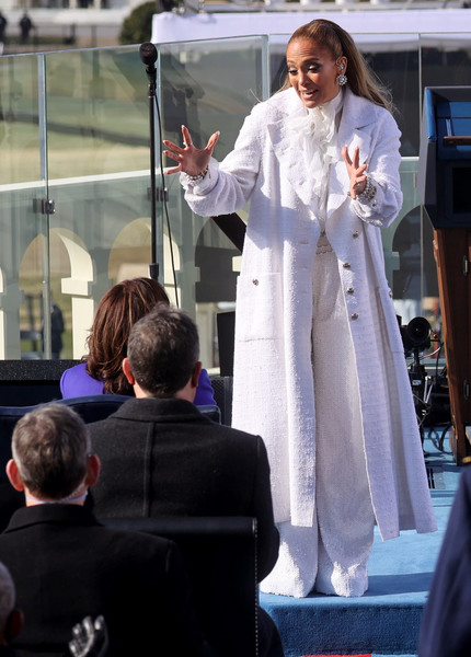 Jennifer Lopez kept warm in style with a white tweed coat by Chanel during Joe Biden's inauguration.